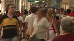 Pedestrians and shoppers on a busy car-free street Stock Footage