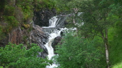 Rapids on a mountains stream in the forest, Scottish Highlands Stock Footage
