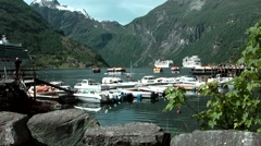 Europe Norway Geirangerfjord 032 fjord scenery behind ships and boats Stock Footage