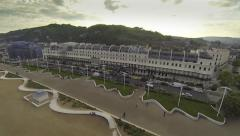 Aerial sunset on a beach with victorian buildings Stock Footage