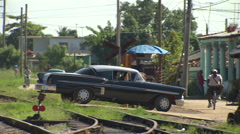 Old American car, railway track and horse buggies Stock Footage