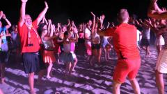 People Crowd Dance at Night Beach Disco Music Party - stock footage