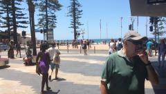 Unidentified people walk to Manly beach in Sydney, Australia. Stock Footage