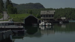 0133Norway lake bay boathouse harber Stock Footage