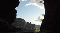 View through rock fomation in Saxon Switzerland Stock Footage