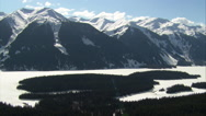 Stock Video Footage of 1080HD cineflex shot of snowy mountains and forest in British Columbia.