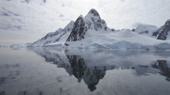 Boat track past mountain in Lemaire Channel, Antarctic Peninsula, Antarctica Stock Footage