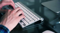 Man is typing in a apple keyboard. Stock Footage