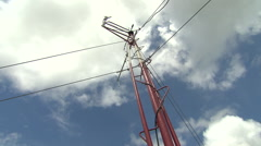 Weather mast against blue sky and fluffy clouds Stock Footage