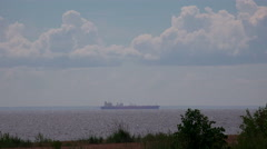 Barge on the horizon. Gulf of Finland. 4K. - stock footage
