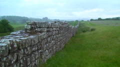 Hadrian's Wall gets lost in the distance and rainfall Stock Footage