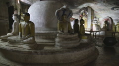 Many sitting and standing Buddhas at the Golden Temple of Dambulla. Stock Footage