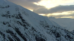 1080HD Cineflex, fly over snowy mountain tops at sunset Stock Footage