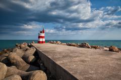 Lighthouse on the tavira island before storm, algarve,portugal  7 Stock Photos