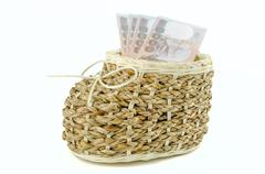basket with money on isolated background - stock photo