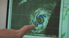 Computer Hurricane satellite eye of the hurricane  with finger pointing Stock Footage