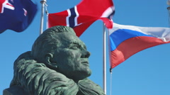 Bust of Admiral Byrd and flags, McMurdo Base, Ross Island, Antarctica Stock Footage