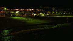 People Dance Night Beach Disco Music Party near sea waves Stock Footage