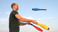 Man Juggling Clubs - stock footage