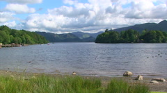 Pan on lake in the mountains at Lake District National Park Stock Footage
