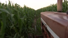 Old Tractor going through Corn Field 1 Stock Footage