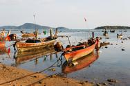Stock Photo of national fishing boats on the shore of the indian ocean phuket thailand