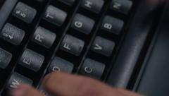 Close up rotating keyboard and typing - paranoia online Stock Footage