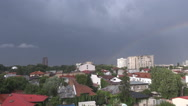 Rainbow over the city on a cloudy weather, rain just stopped, nice cloudscape Stock Footage