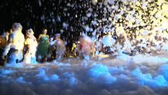 People Crowd Dance at Foam Night Beach Disco Music Party - stock footage