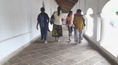 People passing by at the Golden Temple of Dambulla. Stock Footage