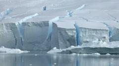 Icebergs in front of ice shelf/glacier edge, Antarctica Stock Footage