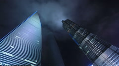Shanghai tallest buildings night time lapse 24 zoom in Stock Footage