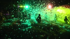 People Crowd Dance at Foam Night Beach Disco Music Party Stock Footage