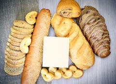Fresh Tasty Bread on Woody Background. - stock photo