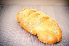 Fresh Tasty Bread on Woody Background. - stock photo