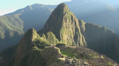 Machu Picchu Huayna Picchu and ruins in morning Stock Footage