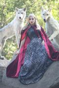 lovely woman posing with wolves outdoors - stock photo