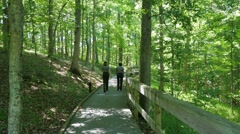 Park Ranger Girls Walking in the Woods at Mammoth Cave HD Stock Footage