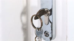 Close up of Key being turned on door Stock Footage