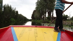 Time-lapse of a trajinera sailing the channels of xochimilco - stock footage