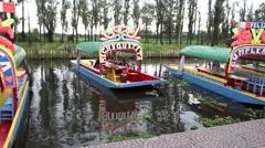 Trajinera boat entering the port - stock footage