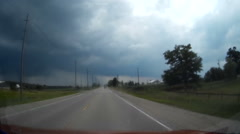 Driving into severe thunderstorm, dark clouds and heavy rain POV shot Stock Footage