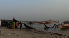 Fishing boats at the sunset, fishermen on the beach, Senegal  Africa Stock Footage