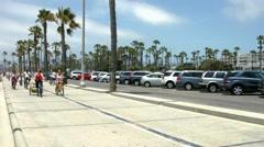 Riding bicycles in Santa Monica, California, BlackMagic 4K Production Camera Stock Footage