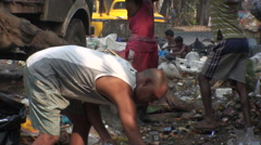 People scavenge through rubbish, Kolkata (formerly Calcutta), India - stock footage