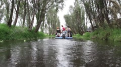 A motor boat moves away at Xochimilco channels - stock footage