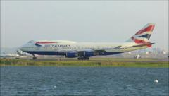 British Airways 747 waters edge - stock footage