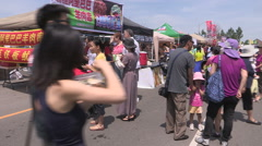 Hot sunny summer day at Asian market festival in Markham Ontario Canada Stock Footage
