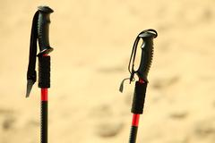 nordic walking. sticks on a sandy beach - stock photo