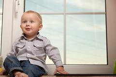 Portrait of smiling little boy child kid in blue shirt Stock Photos